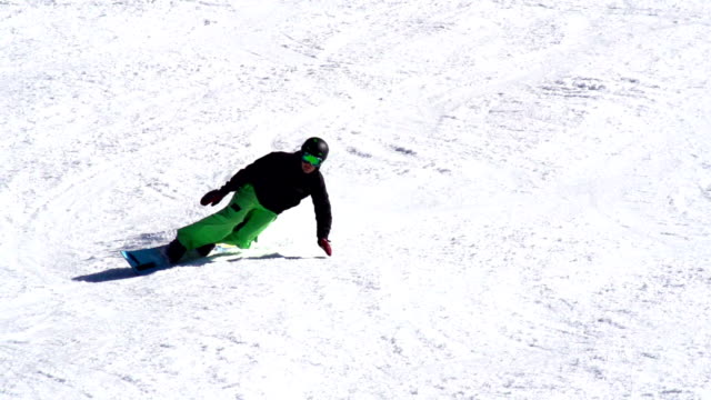 HD: Super Slo-Mo Shot of Snowboarder Extreme Carving video