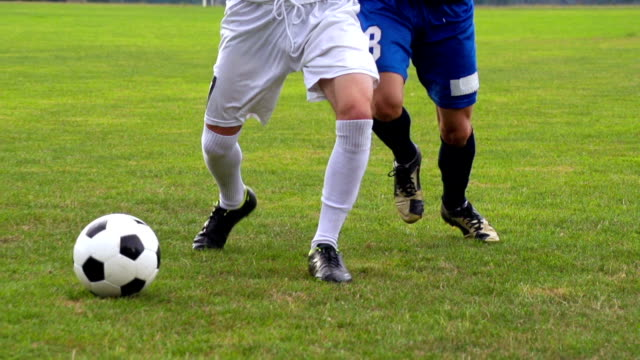 HD Super Slo-Mo Shot of Soccer Players at Aggresive Dribbling video
