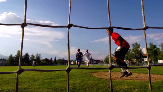 HD: Super Slo-Mo Shot of Young Soccer Players - Goal video