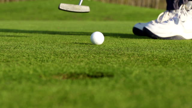 HD Super Slo-Mo:Shot of Golfball Reaching the Hole video