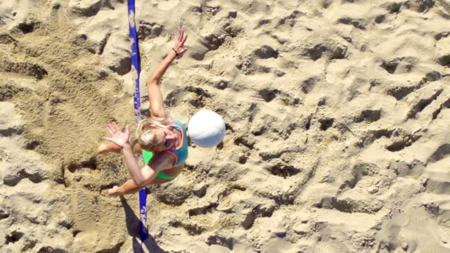 hd super slo-mo:shot of young women playing beach volley - volleyball stock videos and b-roll footage