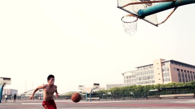 сверхскоростная съёмка баскетбол sport - трюк стоковые видео и кадры b-roll