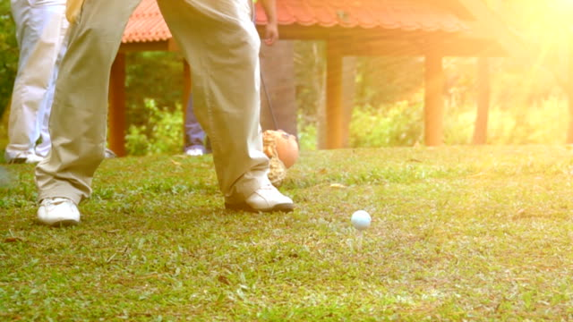 Super Slow motion golfer hitting tee off in beautiful golf course video