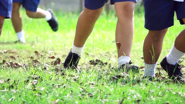 Super Slow motion HD:School children running on the grass ビデオ
