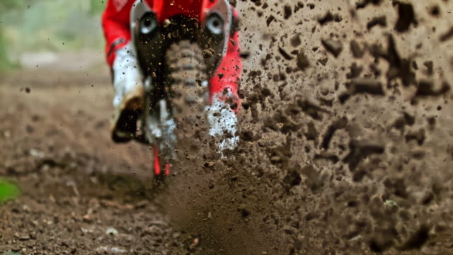 cu super slow motion motocross bike kicking up dirt - motocross video stock e b–roll