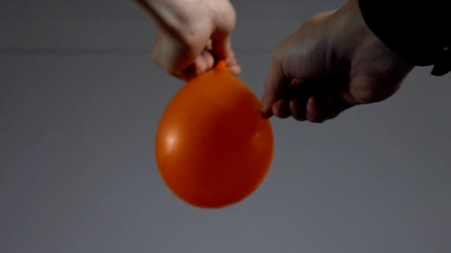 Super slow motion of balloon filled with water exploding