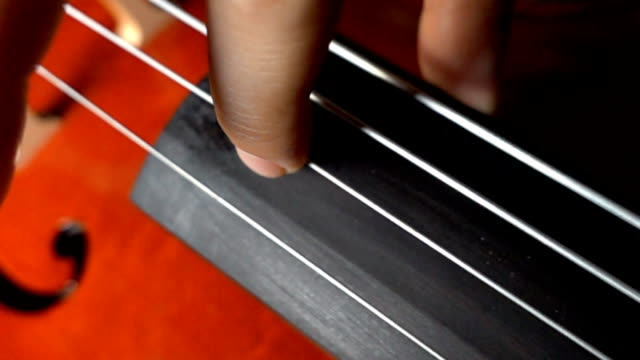 Super slow motion of cello string