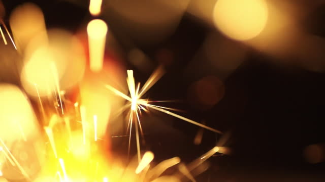 Super slow motion of sparkler stick christmas new year party birthday background video
