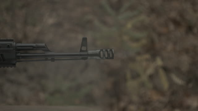 Super slow motion. Shot from Kalashnikov assault rifle video