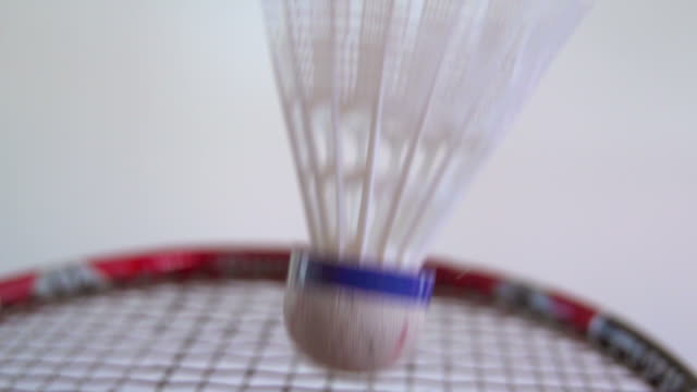 Super slow motion shot of a shuttlecock hitting a badminton racket video