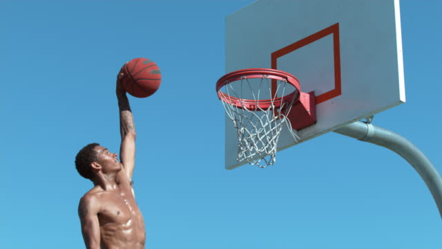 super slow motion shot of basketball basketball slam dunk - basketball stock videos and b-roll footage