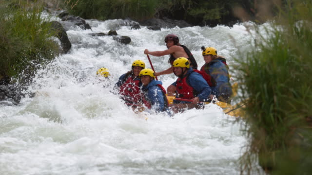 Super slow motion shot of people white water rafting video