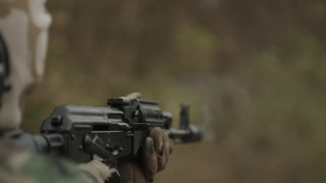 Super slow motion. Sports shooting. Shot from Kalashnikov assault rifle video