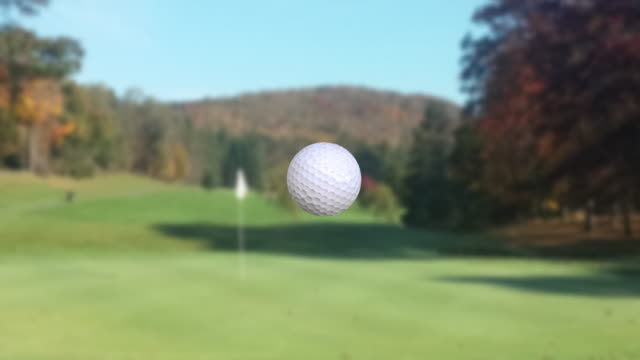 Super slow motion video, golf ball moving to putting green video