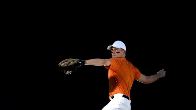 hd super slow-mo: baseball pitcher throwing ball - baseball stok videoları ve detay görüntü çekimi