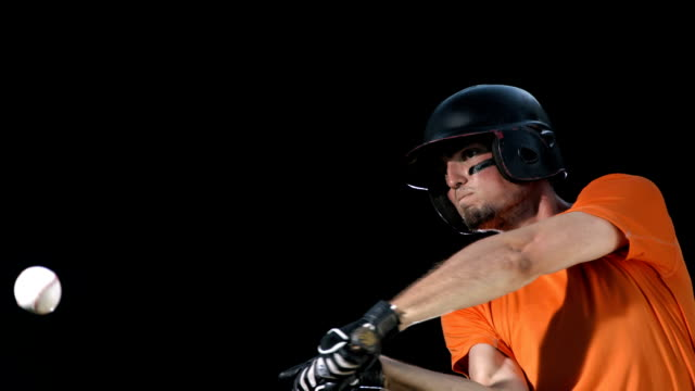 HD Super Slow-Mo: Baseball Player On Black Background video