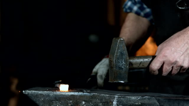 HD Super Slow-Mo: Blacksmith At Work HD1080p: Super Slow Motion shot of a blacksmith hammering a piece of steel. anvil stock videos & royalty-free footage