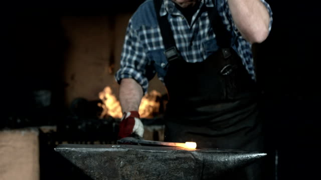HD Super Slow-Mo: Blacksmith Hammering A Hot Metal video