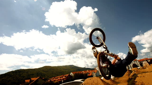 HD Super Slow-Mo: Bmx Dirt Rider Backflipping video