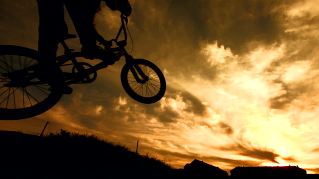 HD Super Slow-Mo: Bmx Racer Jumping At Sunset video