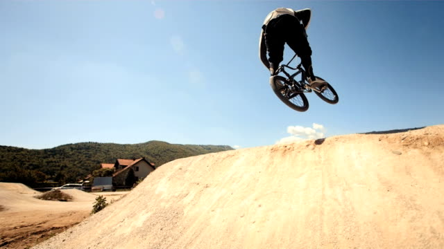 HD Super Slow-Mo: Bmx Rider Jumping Over Dirt video