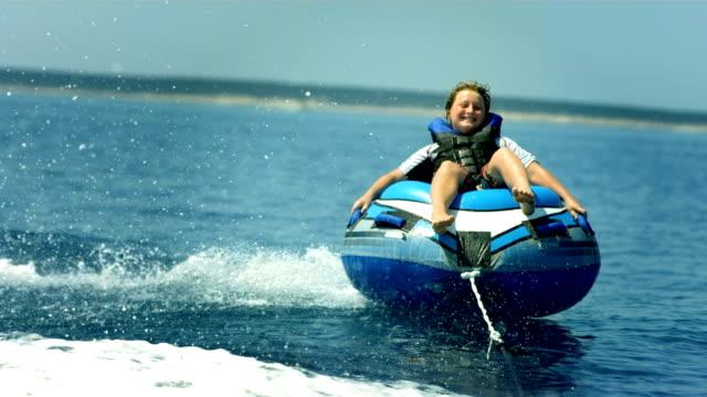 HD Super Slow-Mo: Boy Riding A Towable Tube video