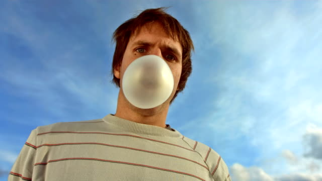 HD Super Slow-Mo: Bubble Popping Over Face video