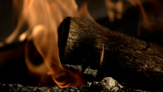 HD Super Slow-Mo: Burning Log In The Fireplace video