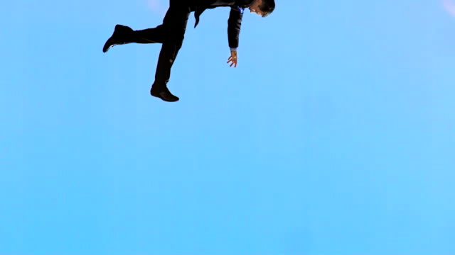 HD Super Slow-Mo: Businessman Falling From The Sky video