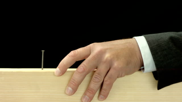 HD Super Slow-Mo: Businessman Hitting A Nail On The Head video