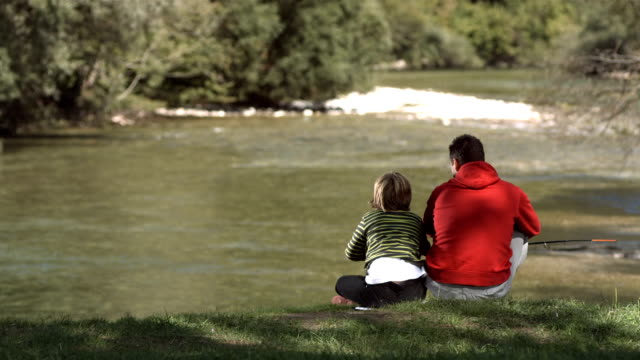 HD Super Slow-Mo: Cheerful Father And Son Fishing video