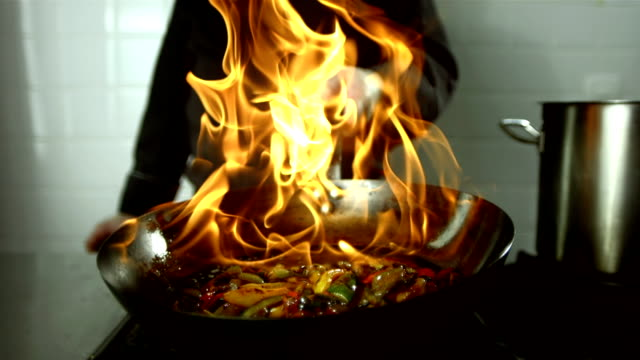 HD Super Slow-Mo: Chef Flambeing Vegetables HD1080p: Super Slow Motion shot of a chef flambeing vegetables on the stovetop. cooking pan stock videos & royalty-free footage