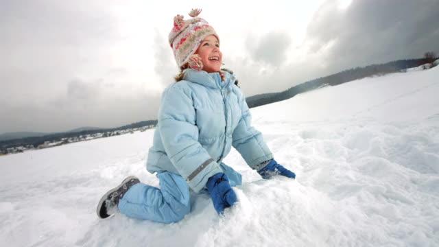 hd super slow-mo: child throwing snow up in the air - snow kids bildbanksvideor och videomaterial från bakom kulisserna