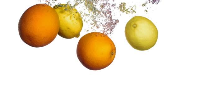 HD Super Slow-Mo: Citrus Fruits Splashing Into Water video