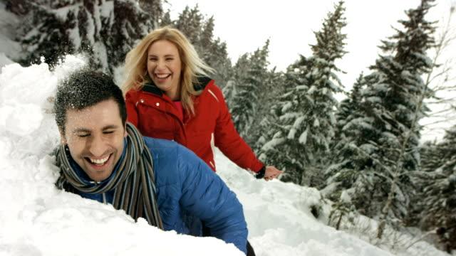 HD Super Slow-Mo: Couple Having Fun In The Snow video