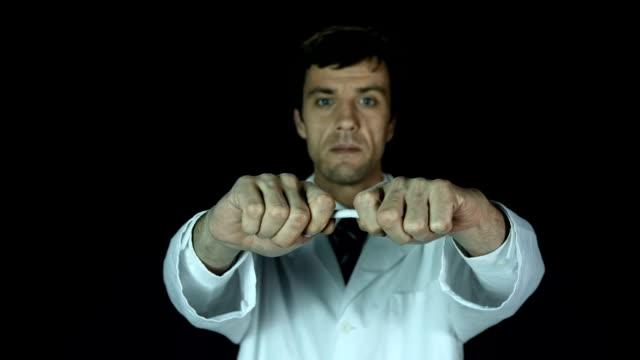 HD Super Slow-Mo: Doctor Breaking A Cigarette video