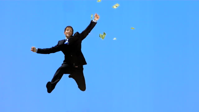 HD Super Slow-Mo: Dollars Falling Over Happy Businessman video