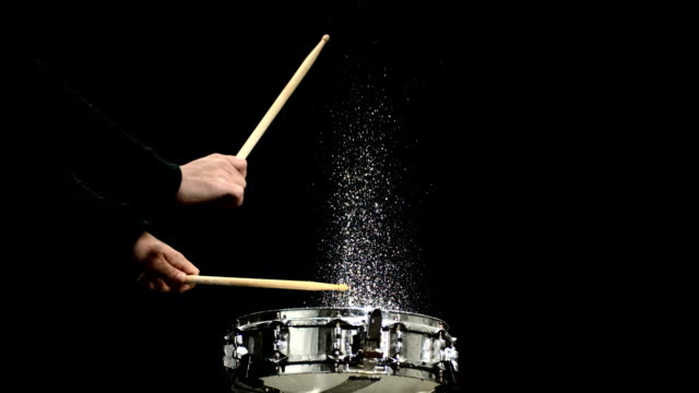 HD Super Slow-Mo: Drummer Splashing Water Off The Drum video