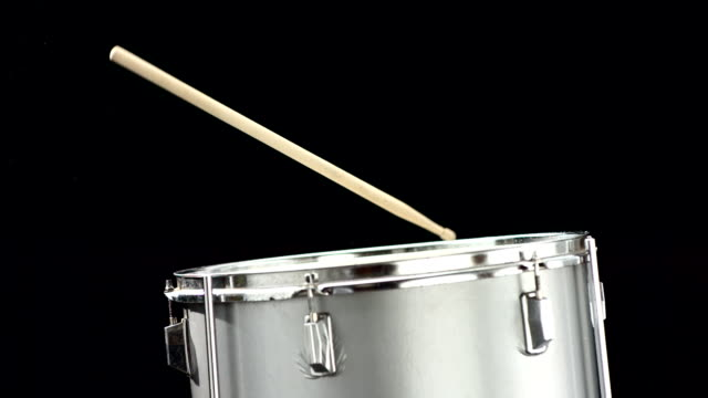HD Super Slow-Mo: Drum-Stick Falling On A Drum video
