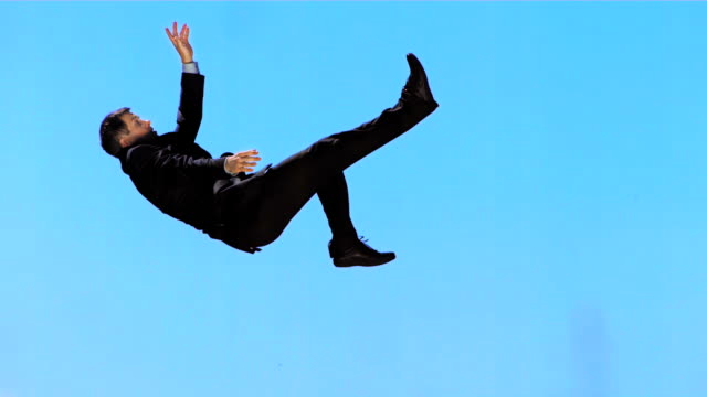 HD Super Slow-Mo: Executive Falling Down