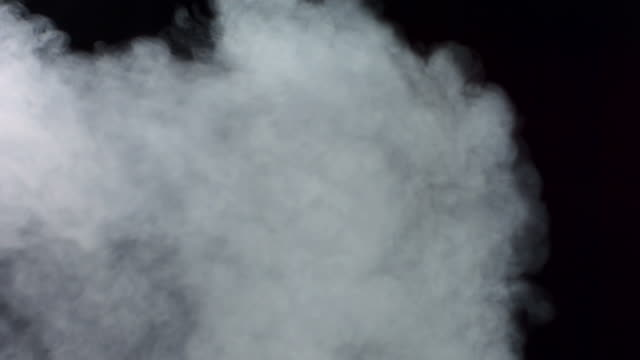 hd super slow-mo: exhaust fume over black background - smoke stok videoları ve detay görüntü çekimi