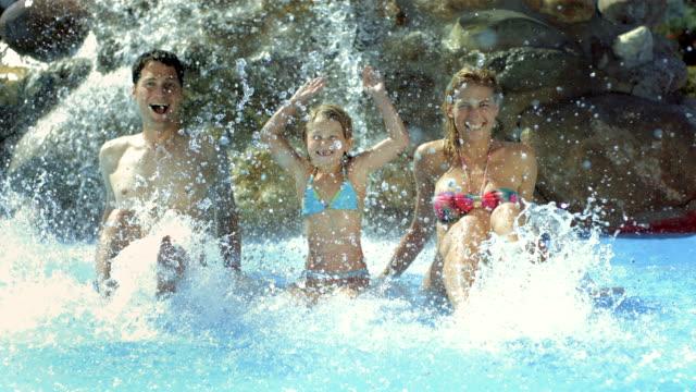 HD Super Slow-Mo: Family Having Fun Splashing Water video