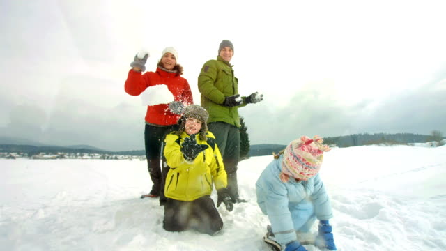 HD Super Slow-Mo: Family Playfully Throwing Snow At Camera video