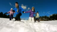 istock HD Super Slow-Mo: Family Trudging Through Snow 479312369