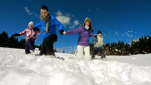 HD Super Slow-Mo: Family Trudging Through Snow video