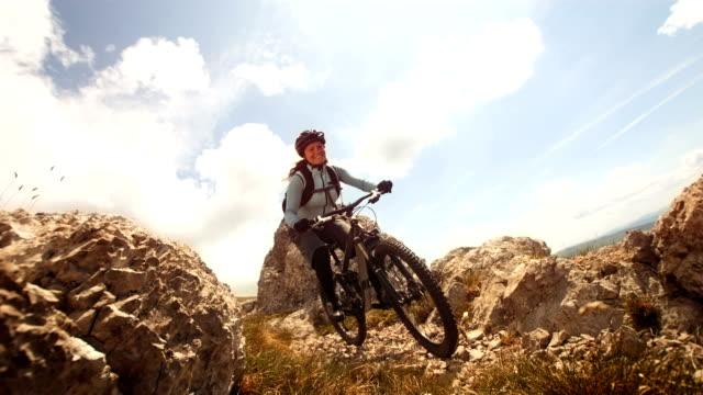 HD Super Slow-Mo: Female Mountain Biker Speeding Downhill video