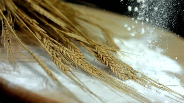 HD Super Slow-Mo: Flour Falling On Wheat HD1080p: Super Slow Motion shot of flour falling on ears of wheat. flour stock videos & royalty-free footage