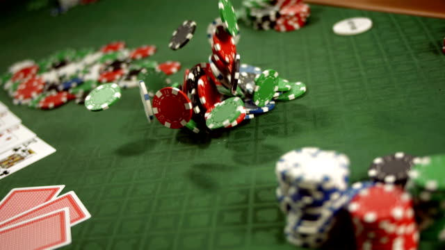 HD Super Slow-Mo: Gambling Chips Falling On A Table video