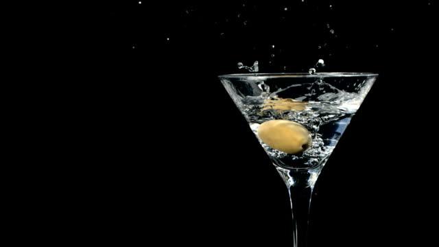 HD Super Slow-Mo: Garnishing Martini With Olive