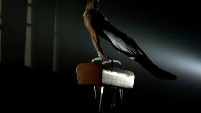 HD Super Slow-Mo: Gymnast Swings On The Pommel Horse